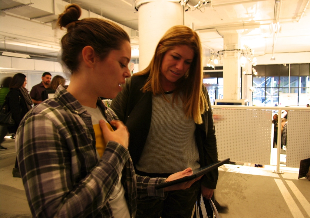 Kika Gilbert (Community Manager of Tinybop) left, demoing Homes app to Kim Kelleher (Publisher of Wired) right.